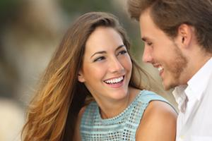 woman smiling at man | teeth whitening des moines ia